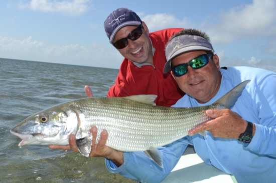 Ray Lombard's grin matches the size of his bonefish with Capt. Joe Gonzalez.